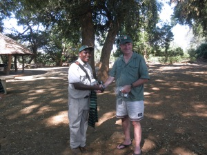 Frank Mabasa receives a RFCG cap, coffee mug and T shirt from Eelco Meyjes in appreciation for his valuable services as a bird guide